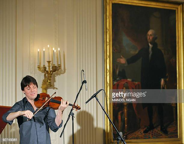Grammy awardwinning violinist Joshua Bell performs during a classical music student workshop concert on November 4 2009 in the East Room of the White...