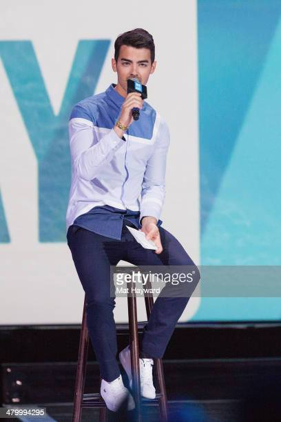 Grammy nominated multiplatinum artist and Free The Children ambassador Joe Jonas speaks on stage during We Day at Key Arena on March 21 2014 in...