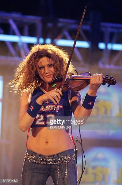 Grammy winner Miri BenArii performs during the NBA AllStar Saturday Night 19 February 2005 in Denver Colorado AFP PHOTO/DON EMMERT