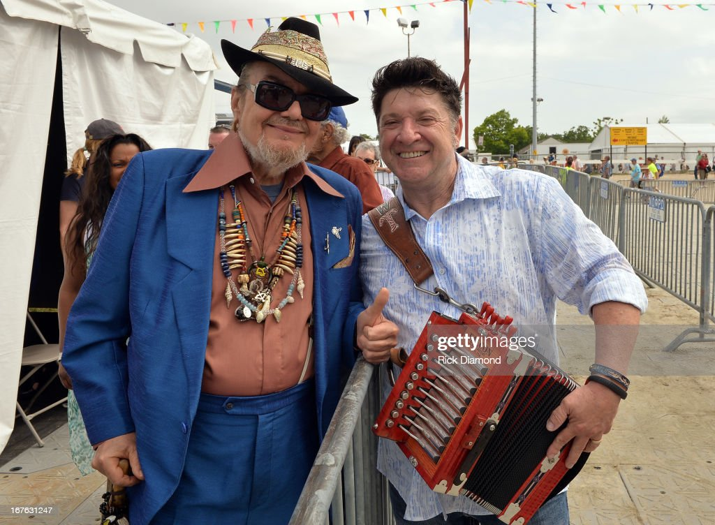 Grammy winners <a gi-track='captionPersonalityLinkClicked' href=/galleries/search?phrase=Dr.+John+-+Musician&family=editorial&specificpeople=4012792 ng-click='$event.stopPropagation()'>Dr. John</a> and Wayne Toups backstage during the 2013 New Orleans Jazz & Heritage Music Festival presented by Shell at Fair Grounds Race Course on April 26, 2013 in New Orleans, Louisiana.
