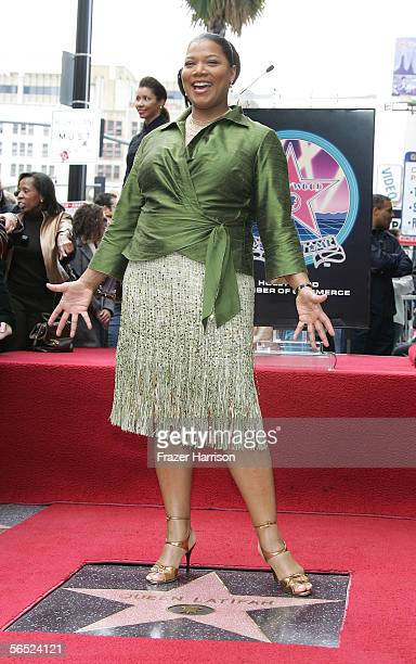 Grammywinning rapper Queen Latifah poses with her new star on the Hollywood WalkOfFame January 4 2006 in Hollywood California