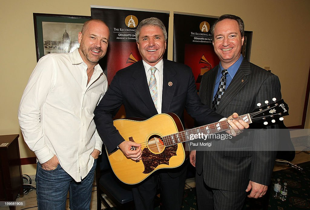 Grammy-winning/songwriter/producer J.R. Stewart (L), Rep. Michael T. McCaul, R-Texas, and The Recording Academy's chief advocacy and industry relations officer Daryl Friedman pose for a photo with a Gibson Country Western guitar at a musical briefing and Welcome Back to Congress Event presented by The Recording Academy's 'Grammys on the Hill' at U.S. House of Representatives on January 16, 2013 in Washington, DC.