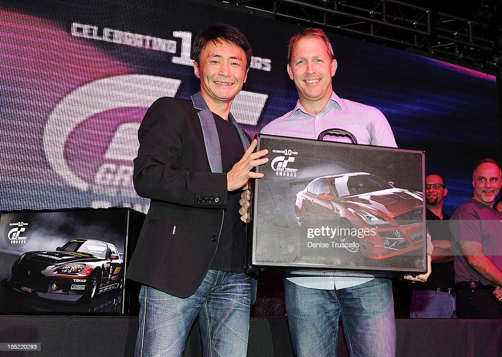 Gran Turismo creator Kazunori Yamauchi and Best European Import winner Jamie Vondruska during the 10th Annual Gran Turismo Awards at The Palms Casino Resort on November 1, 2012 in Las Vegas, Nevada.
