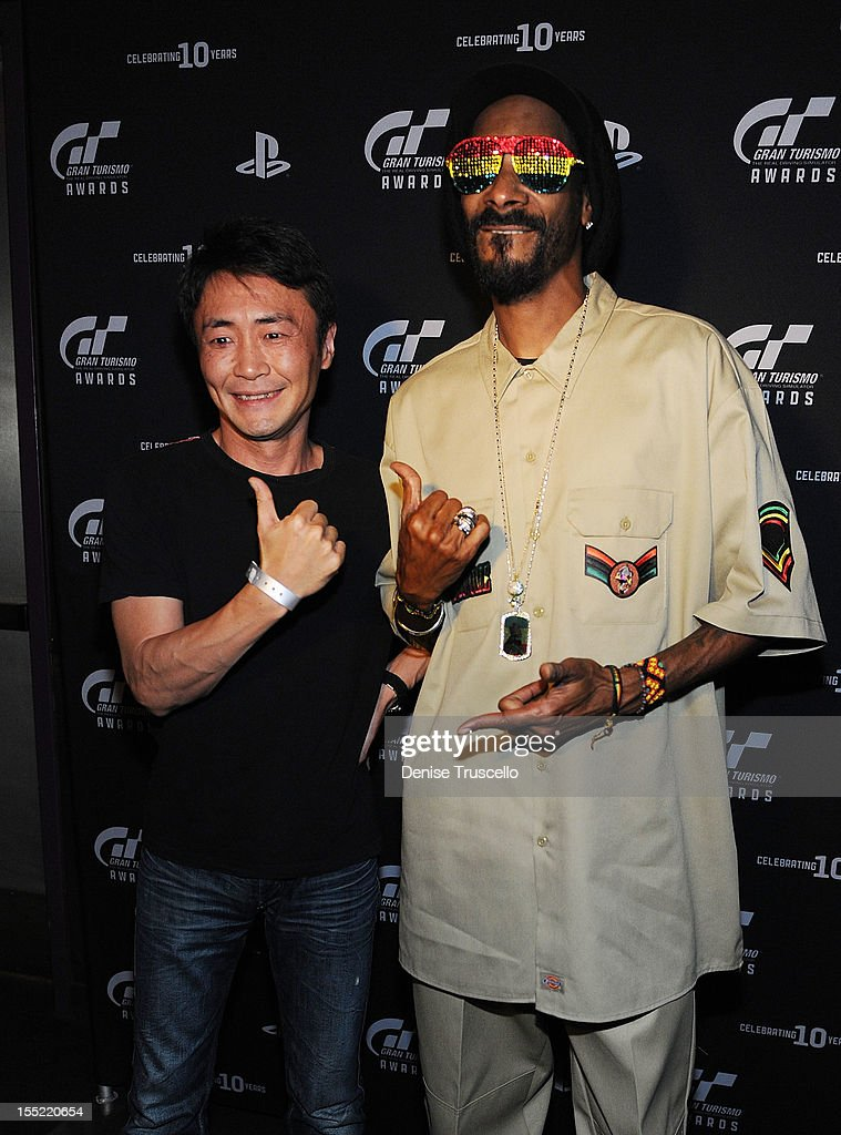 Gran Turismo creator Kazunori Yamauchi and <a gi-track='captionPersonalityLinkClicked' href=/galleries/search?phrase=Snoop+Dogg&family=editorial&specificpeople=175943 ng-click='$event.stopPropagation()'>Snoop Dogg</a> pose for photos at Playstation's 10th Annual Gran Turismo Awards at The Palms Casino Resort on November 1, 2012 in Las Vegas, Nevada.