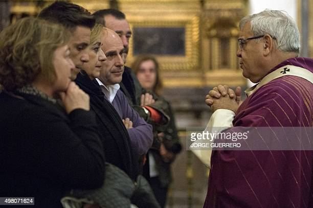 Granada Archbishop Francisco Javier Martinez Fernandez gives condolences to family members of Juan Alberto Gonzalez Garrido one of the victims of the...