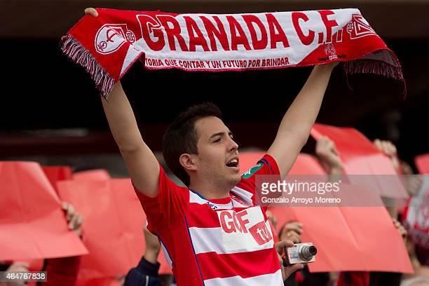 Granada CF fan cheers his team prior to start the La Liga match between Granada CF and FC Barcelona at Nuevo Estadio de los Carmenes on February 28...