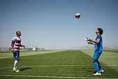 Granada CF football team's new players Mexican goalkeeper Guillermo Ochoa and Brazilian defender Gabriel Silva play with a ball during their official...