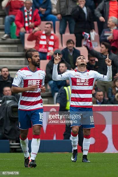 Granada's Belgian midfielder Andreas Pereira celebrates a goal beside Granada's Moroccan midfielder Mehdi Carcela during the Spanish league football...