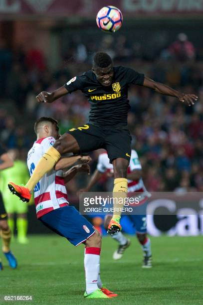 Granada's Belgian midfielder Andreas Pereira vies with Atletico Madrid's Ghanaian midfielder Thomas Partey during the Spanish league football match...