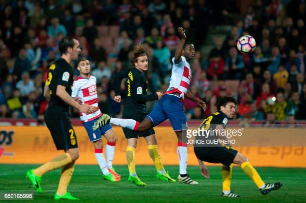 Granada's Colombian forward Adrian Ramos vies with French forward Antoine Griezmann and Argentinian midfielder Nicolas Gaitan during the Spanish...