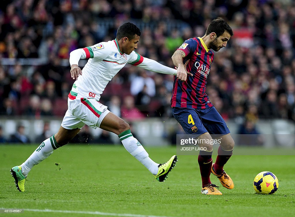 Granada's Colombian forward Jeison Murillo vies with Barcelona's midfielder Cesc Fabregas during the Spanish league football match FC Barcelona vs...