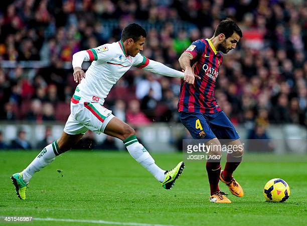 Granada's Colombian forward Jeison Murillo vies with Barcelona's midfielder Cesc Fabregas during the Spanish league football match FC Barcelona vs...