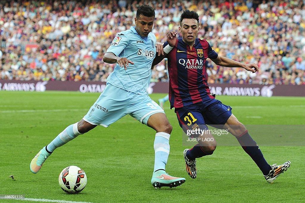 Granada's Colombian forward Jeison Murillo vies with Barcelona's forward Munir during the Spanish league football match FC Barcelona vs Granada CF at...
