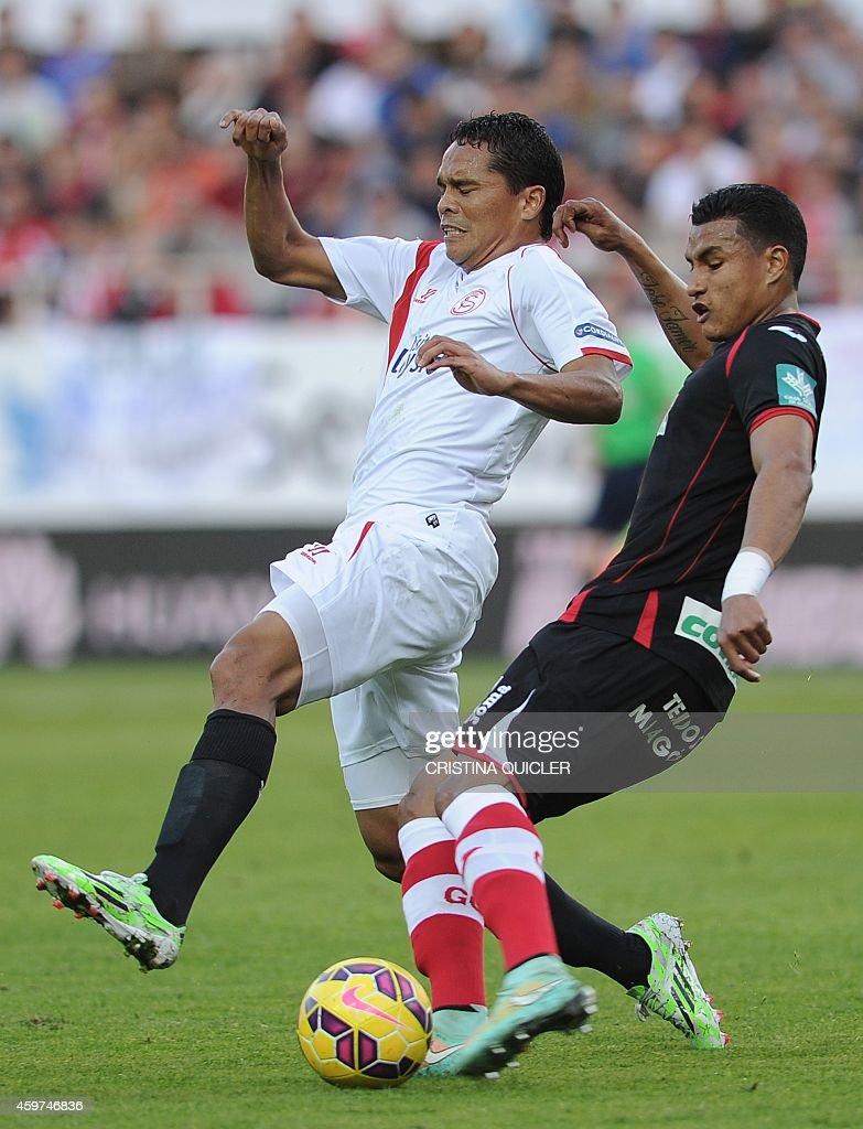 Granada's Colombian forward Jeison Murillo vies with Sevilla's Colombian forward Carlos Bacca during the Spanish league football match Sevilla FC vs...