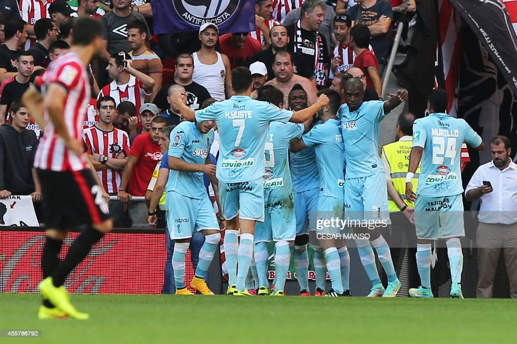Granada's Colombian forward Jhon Andres Cordoba celebrates with teammates after scoring during the Spanish league football match Athletic Club Bilbao...
