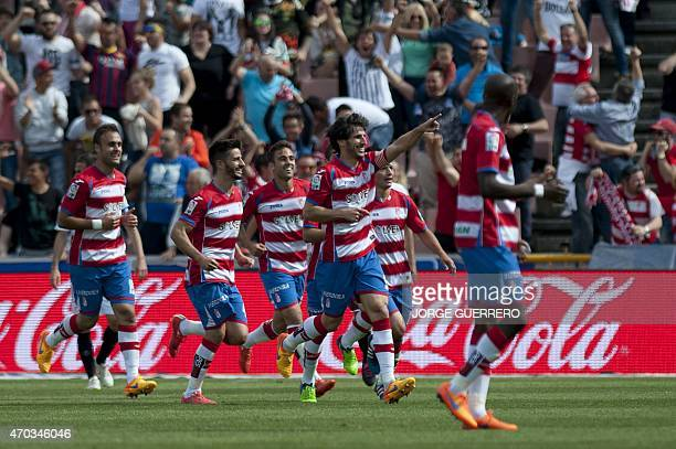 Granada's defender Diego Mainz celebrates with teammates after scoring a goal during the Spanish league football match Granada FC v Sevilla FC at...