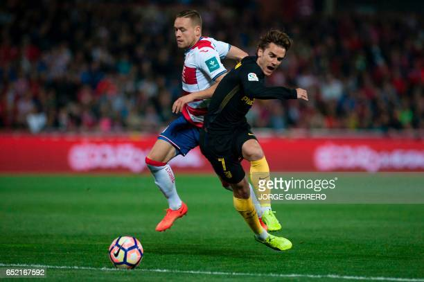 Granada's Icelandic defender Sverrir Ingi Ingason vies with Atletico Madrid's French forward Antoine Griezmann during the Spanish league football...