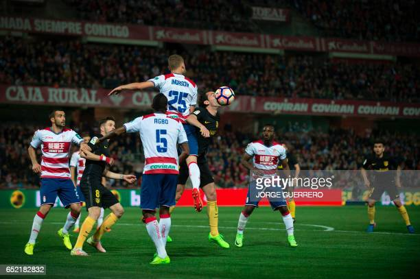 Granada's Icelandic defender Sverrir Ingi Ingason vies with Atletico Madrid's Uruguayan defender Diego Godin during the Spanish league football match...