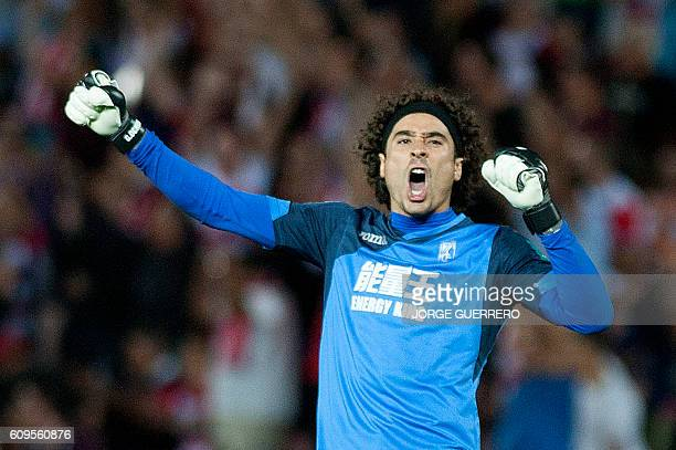Granada's Mexican goalkeeper Guillermo Ochoa celebrates his team's goal during the Spanish league football match Granada CF vs Athletic Club de...