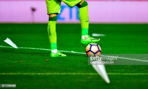 Granada's Mexican goalkeeper Guillermo Ochoa stands amongst paper airplanes fallen on the pitch during the Spanish league football match Sevilla FC...