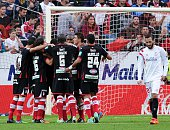 Granada's Moroccan forward Youssef ElArabi celebrates with his teammates after scoring during the Spanish league football match Sevilla FC vs Granada...