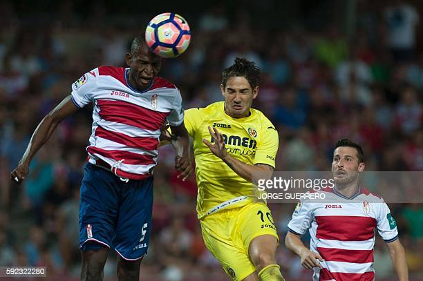 Granada's Nigerian defender Agbo Uche and defender Roberto Roman Triguero vies with Villarreal's Brazilian forward Rodrigues da Silva Pato during the...
