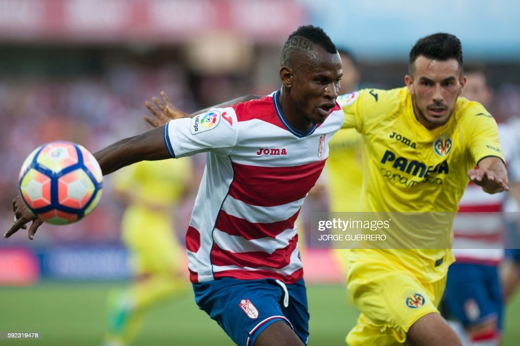 Granada's Nigerian defender Agbo Uche vies with Villarreal's German forward Nicola Sansone during the Spanish league football match Granada FC vs...
