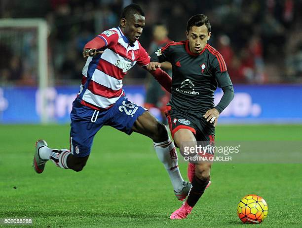 Granada's Nigerian midfielder Uche Henry Agbo vies with Celta Vigo's Chilean forward Fabian Orellana during the Spanish league football match Granada...