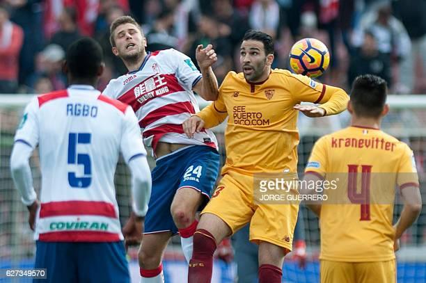 Granada's Ukrainian forward Artem Kravets vies with Sevilla's French defender Adil Rami during the Spanish league football match Granada CF vs...