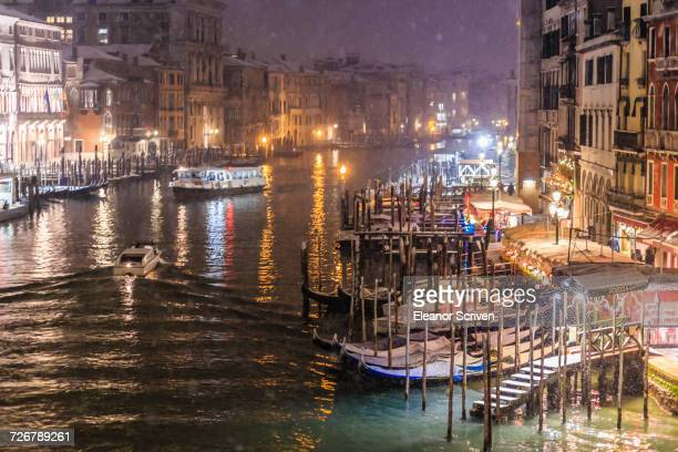 Grand Canal from Rialto Bridge during rare snowfall on a winter evening, Venice, UNESCO World Heritage Site, Veneto, Italy, Europe