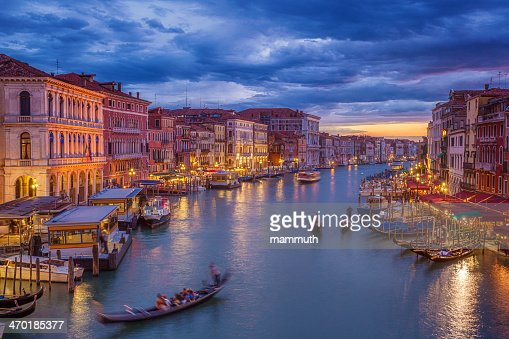 Grand Canal of Venice after sunset with gondola