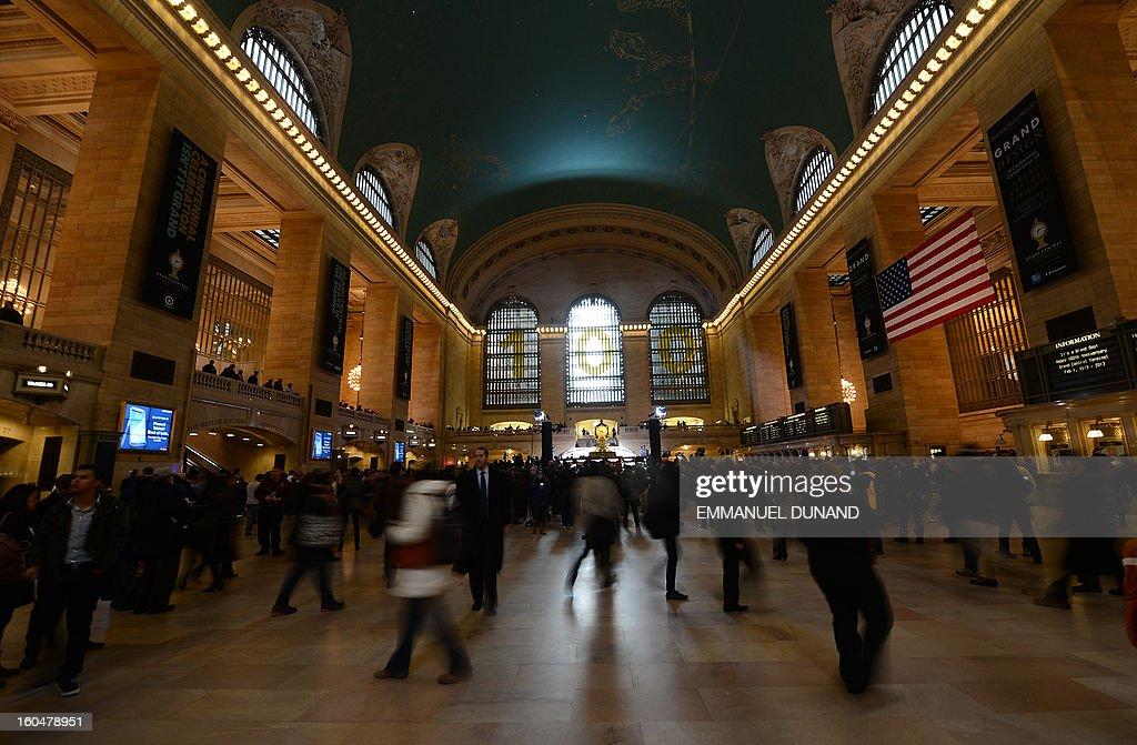 Grand Central Terminal is decorated for its centennial celebrations in New York, February 1 , 2013 . Grand Central Terminal, the doyenne of US train stations, is celebrating its 100th birthday on February 2, 2013. Opened on February 2, 1913, when trains were a luxurious means of traveling across America, the New York landmark with its Beaux-Arts facade is still one of the US largest transportation hubs and is also New York's second-most-popular tourist attraction, after Times Square. AFP PHOTO/Emmanuel Dunand