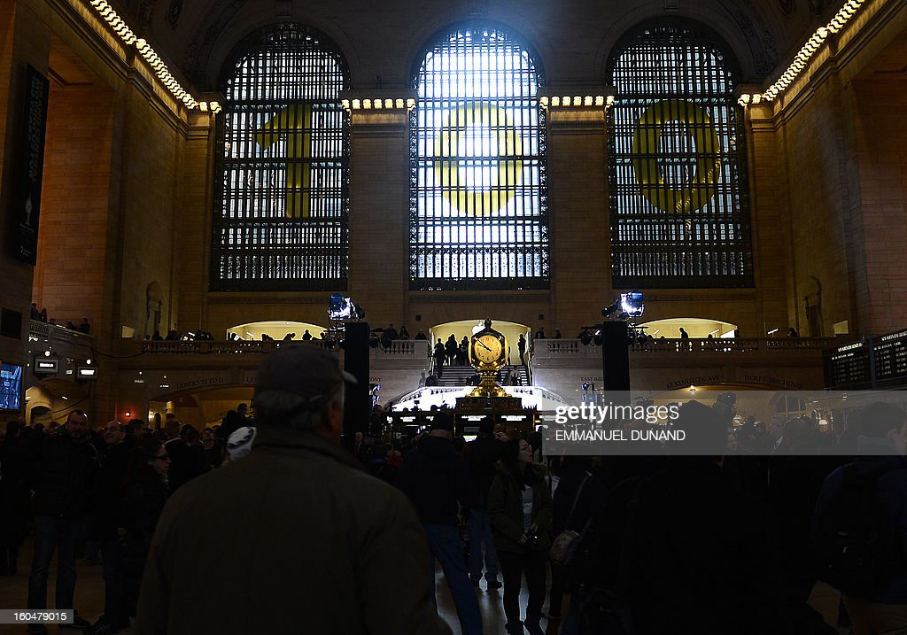 Grand Central Terminal is decorated for its centennial celebrations in New York, February 1 , 2013 . Grand Central Terminal, the doyenne of US train stations, is celebrating its100th birthday on February 2, 2013. Opened on February 2, 1913, when trains were a luxurious means of traveling across America, the New York landmark with its Beaux-Arts facade is still one of the US largest transportation hubs and is also theNew York's second-most-popular tourist attraction, after Times Square. AFP PHOTO/Emmanuel Dunand