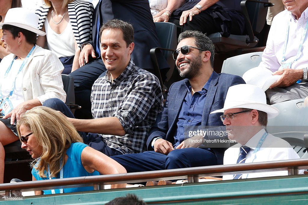 Grand Corps Malade, alias Fabien Marsaud, (L) and friend attends the 2016 French Tennis Open - Day Six at Roland Garros on May 27, 2016 in Paris, France.
