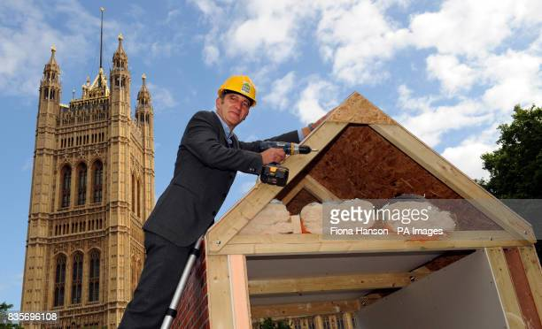 Grand Designs presenter Kevin McCloud joins in the build of an insulated construction at Victoria Tower Gardens Westminster London to launch the...