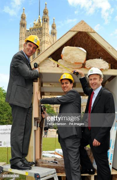 Grand Designs presenter Kevin McCloud with Secretary of State for Energy and Climate Change Ed Miliband and Housing Minister John Healey joining in...
