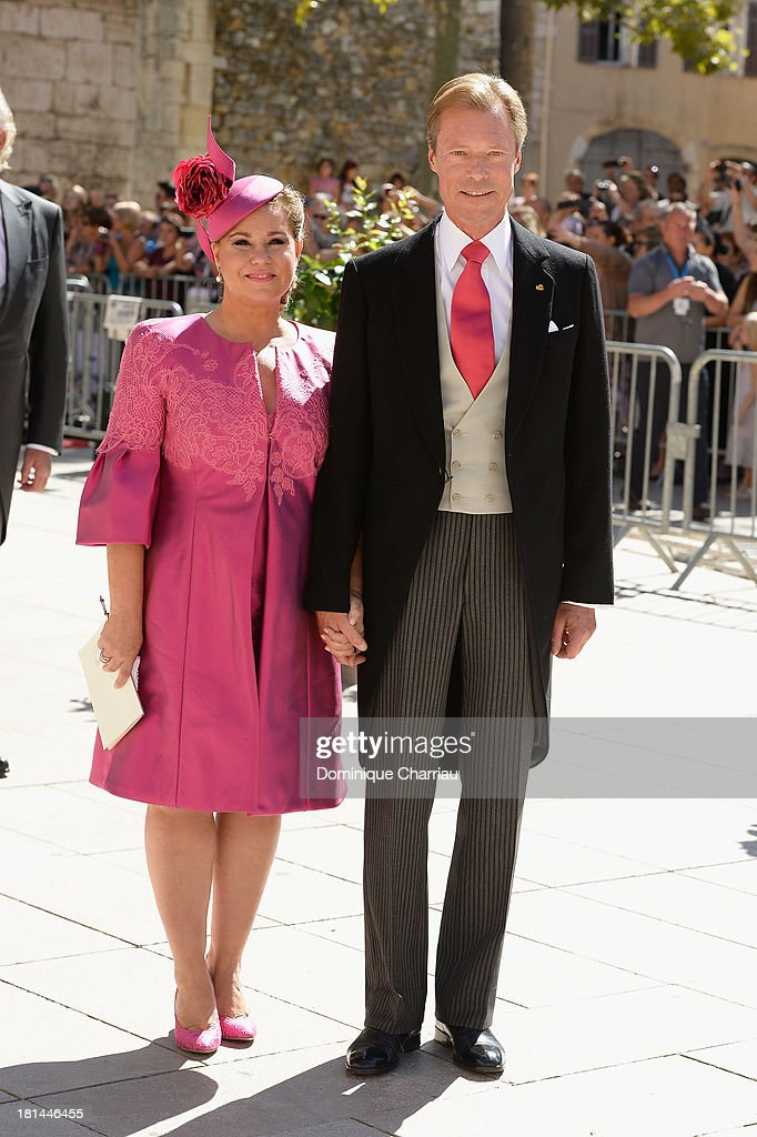 Grand Duchess Maria Teresa and Grand Duke Henri depart from the Religious Wedding Of Prince Felix Of Luxembourg and Claire Lademacher at Basilique Sainte Marie-Madeleine on September 21, 2013 in Saint-Maximin-La-Sainte-Baume, France.
