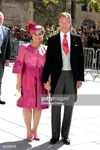 Grand Duchess Maria Teresa and Grand Duke Henri depart from the Religious Wedding Of Prince Felix Of Luxembourg and Claire Lademacher at Basilique...