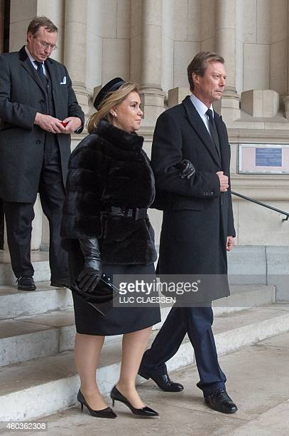 Grand Duchess Maria Teresa and Grand Duke Henri of Luxemburg leave the church NotreDame after the funeral service of the late queen dowager Fabiola...