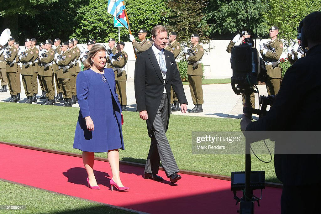 Grand Duchess Maria Teresa of Luxembourg and Grand Duke Henri of Luxembourg celebrate National Day during the parade on June 23, 2014 in Luxembourg, Luxembourg.
