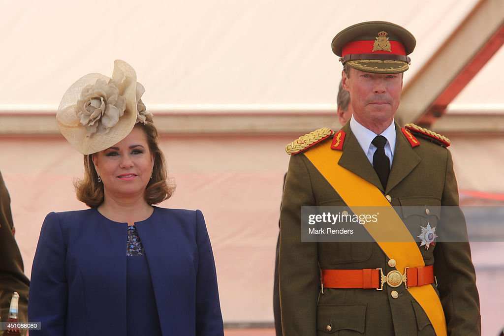 <a gi-track='captionPersonalityLinkClicked' href=/galleries/search?phrase=Grand+Duchess+Maria+Teresa&family=editorial&specificpeople=159000 ng-click='$event.stopPropagation()'>Grand Duchess Maria Teresa</a> of Luxembourg and Grand Duke Henri of Luxembourg celebrate National Day during the parade on June 23, 2014 in Luxembourg, Luxembourg.