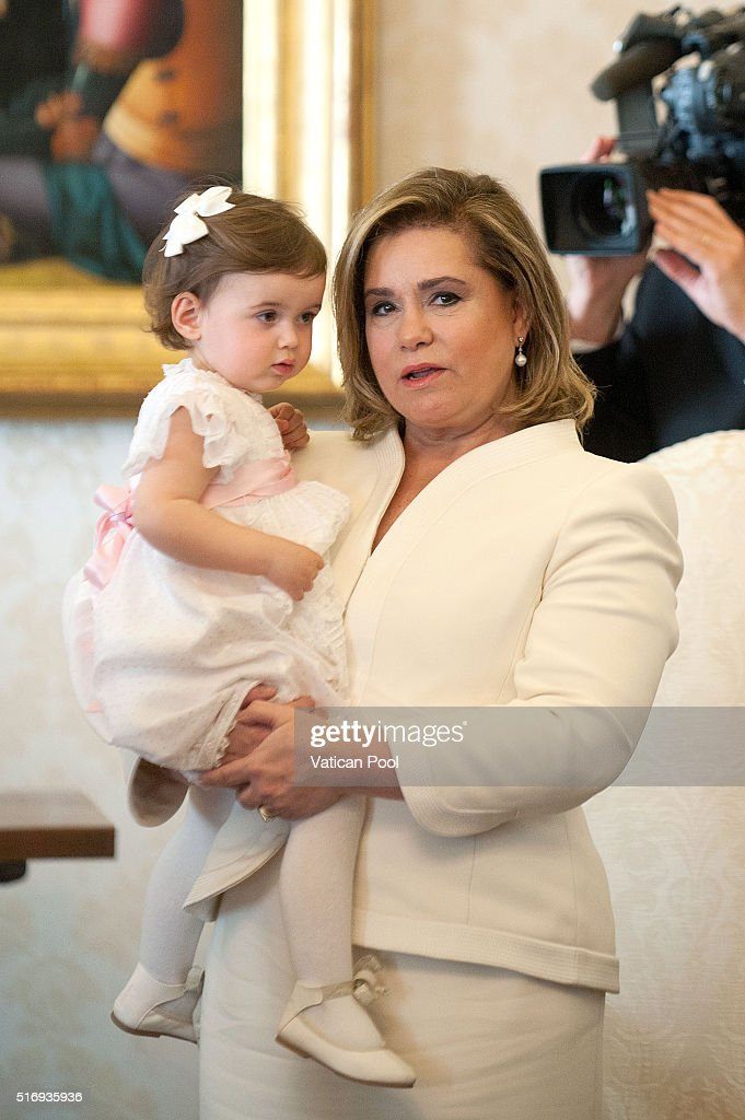 Grand Duchess Maria Teresa of Luxembourg and Princess Amalia Gabriela Maria Teresa during a meeting with Pope Francis at his private library in the Apostolic Palace on March 21, 2016 in Vatican City, Vatican. During the audience the Royal Family of Luxembourg gave the Holy Father a family portrait, with the Spanish-language dedication, 'To our Pope Francis, with the respectful and filial affection our whole family.' Pope Francis gave the family a medal of the pontificate and copies of his Apostolic Exhortation, Evangelii gaudium, and his Encyclical Letter, Laudato si'.