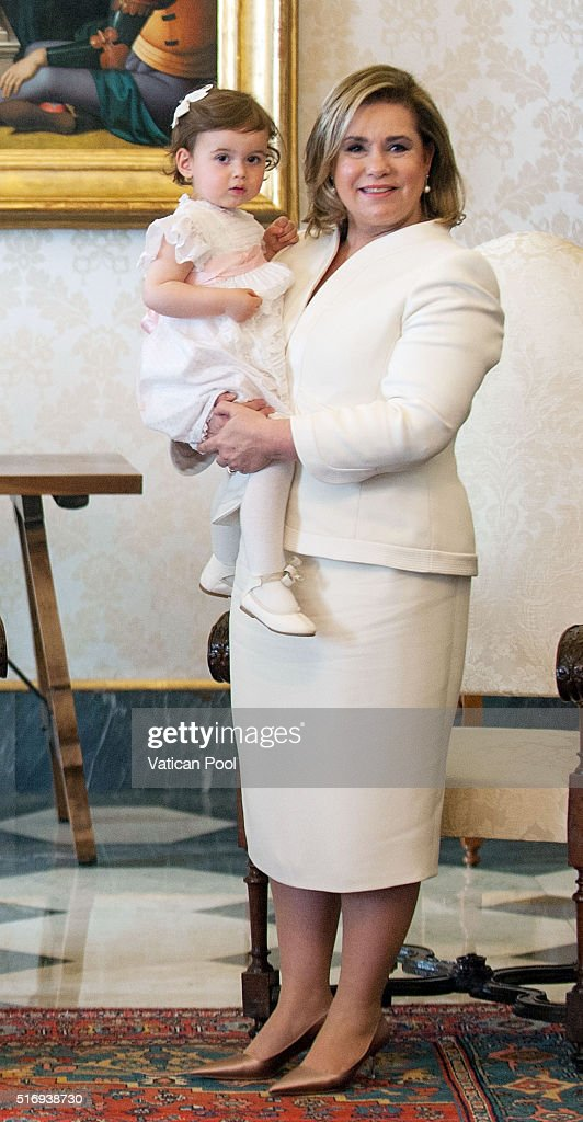 Grand Duchess Maria Teresa of Luxembourg and Princess Amalia Gabriela Maria Teresa during a meeting with Pope Francis at his private library in the Apostolic Palace on March 21, 2016 in Vatican City, Vatican. During the audience the Royal Family of Luxembourg gave the Holy Father a family portrait, with the Spanish-language dedication, 'To our Pope Francis, with the respectful and filial affection our whole family.' Pope Francis gave the family a medal of the pontificate and copies of his Apostolic Exhortation, Evangelii gaudium, and his Encyclical Letter, Laudato siÕ.