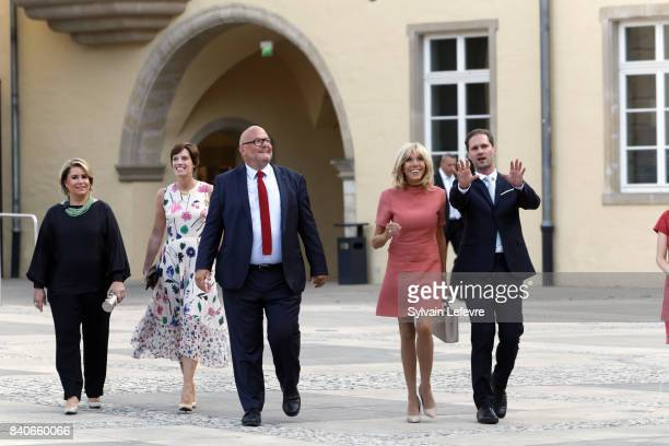 Grand Duchess Maria Teresa of Luxembourg Belgian Prime Minister's partner Amelie Derbaudrenghien guest Brigitte MacronTrogneux France's first lady...