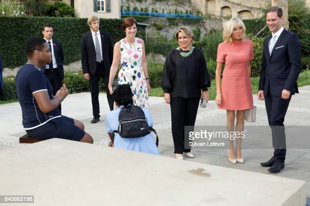 Grand Duchess Maria Teresa of Luxembourg Belgian Prime Minister's partner Amelie Derbaudrenghien Brigitte MacronTrogneux France's first lady...