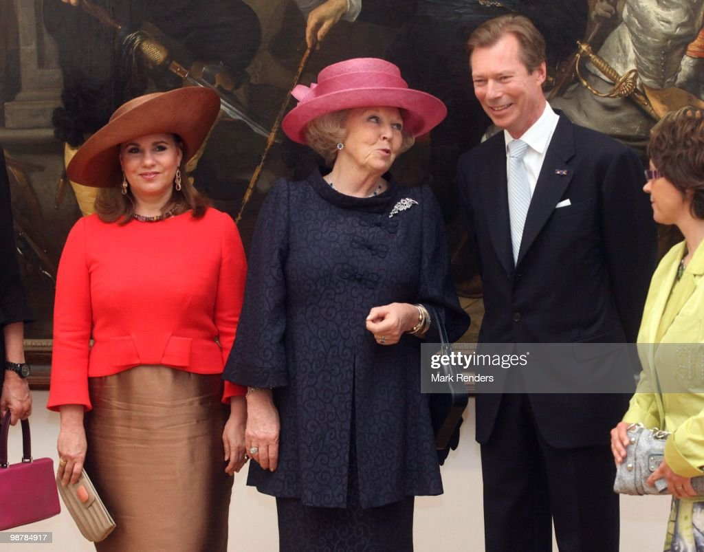 <a gi-track='captionPersonalityLinkClicked' href=/galleries/search?phrase=Grand+Duchess+Maria+Teresa&family=editorial&specificpeople=159000 ng-click='$event.stopPropagation()'>Grand Duchess Maria Teresa</a> of Luxembourg, Grand Duke Henri of Luxembourg and Queen <a gi-track='captionPersonalityLinkClicked' href=/galleries/search?phrase=Beatrix+of+the+Netherlands&family=editorial&specificpeople=92396 ng-click='$event.stopPropagation()'>Beatrix of the Netherlands</a> attend the inauguration exhibition 'The Golden Age Reloaded' following renovations at Villa Vaubanon May 1, 2010 in Luxembourg, Luxembourg.