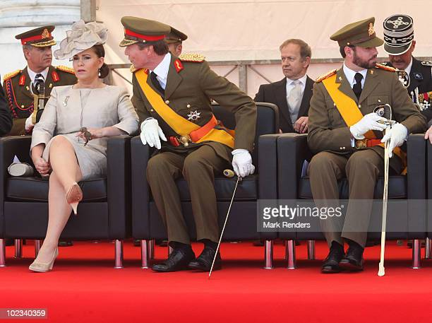 Grand Duchess Maria Theresa of Luxembourg and Grand Duke Henri of Luxembourg and Prince Guillaume of Luxembourg watch the parade on Luxembourg's...