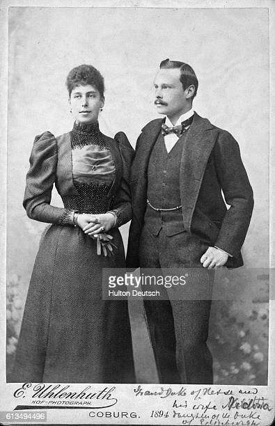 Grand Duchess Victoria Melita Princess of Edinburgh and SaxeCoburg and Gotha stands with her husband ErnstLudwig Grand Duke of Hesse and the Rhein in...
