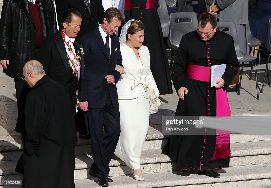 Grand Duke Henri (C) and Grand Duchess Maria Teresa of Luxembourg (2R) arrive for the Inauguration Mass for Pope Francis in St Peter's Square on March 19, 2013 in Vatican City, Vatican. The mass is being held in front of an expected crowd of up to one million pilgrims and faithful who have filled the square and the surrounding streets to see the former Cardinal of Buenos Aires officially take up his role as pontiff. Pope Francis' inauguration takes place in front of Cardinals and spiritual leaders as well as heads of state from around the world.