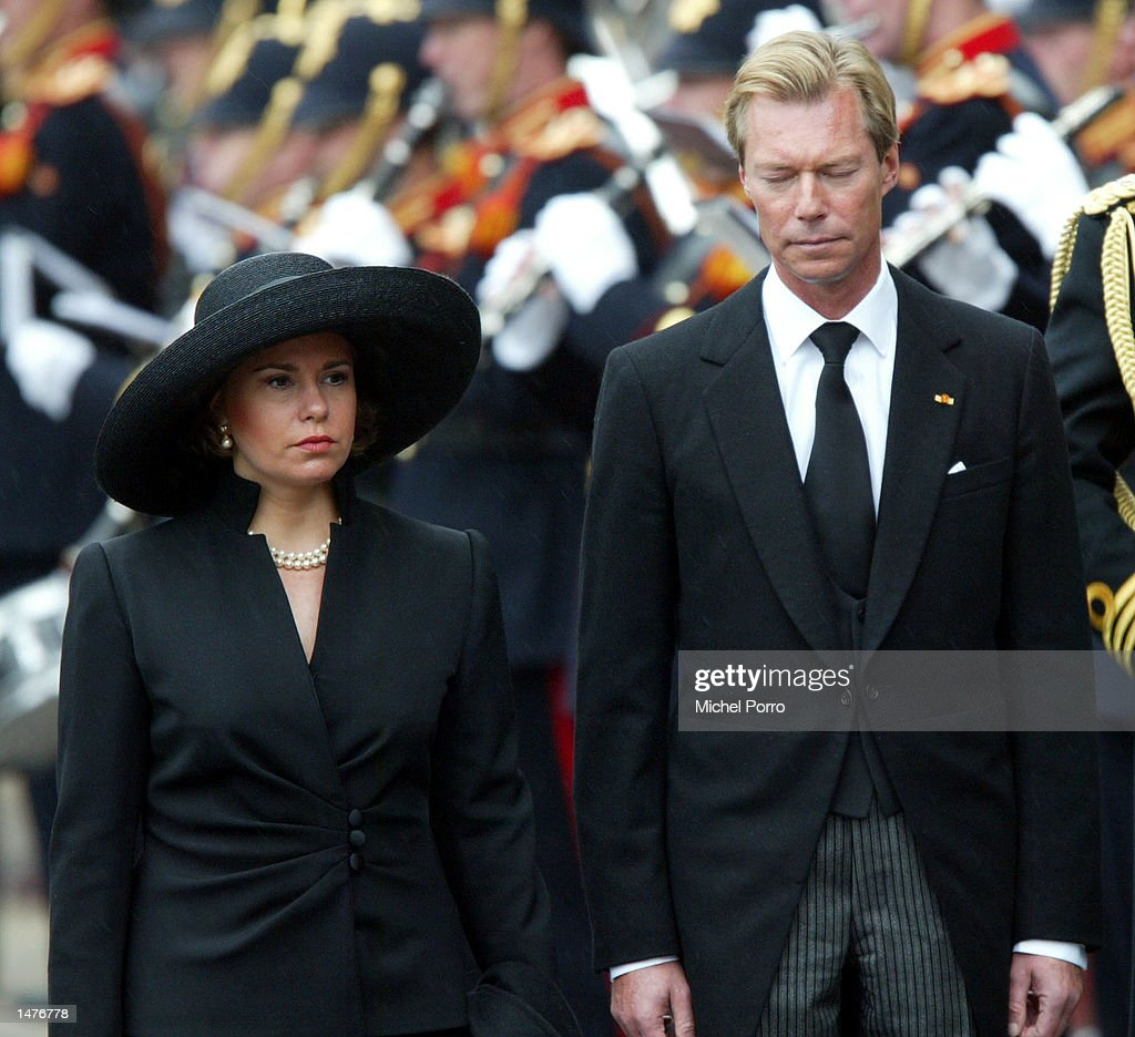 Grand Duke Henri and his wife Grand Duchess Maria Teresa bow to the Dutch Royal Standard after the funeral ceremony of Prince Claus of the Netherlands October 15, 2002 in Delft, Netherlands. Prince Claus, husband to Queen Beatrix, died October 6, 2002 after a long battle with Parkinson's disease and pneumonia.